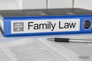 Blue Binder With Family Law Label Sitting on Table Next To Pen