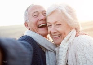 Joyous Elderly Couple Embracing Each Other