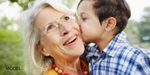 Little Boy Kissing Grandma on the Cheek